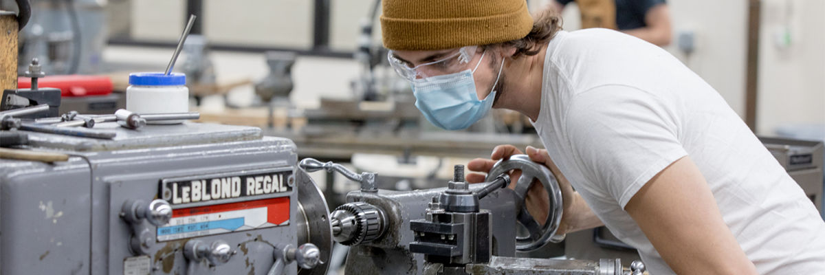 A student working in the machine shop